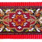 Metallic gold tapestry of green, red and gold Martingale Lead