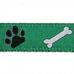 1MC573 Dog Paws and Bones on Green